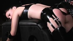 Latex clad Morgan Monroe and Kim Lee in BDSM teasing and torture