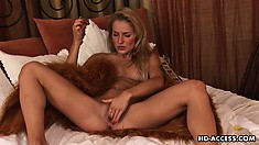Dazzling blonde Monica shows off her sexy body and satisfies her needs with a dildo