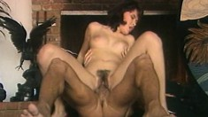 Kristara Barrington bounces on Peter North's big dick by the fireplace