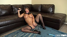 Busty Asian Ava Devine toys her shaved cunt on the floor and poses