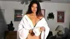 Vivian lets her hairy bush peek through her mesh underwear while posing