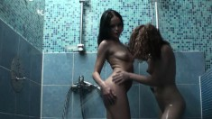 A pack of insatiable girls engage in a lesbian fuck fest in a bathhouse