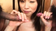 Gorgeous Japanese milf gets her pussy pleased and worships two dicks