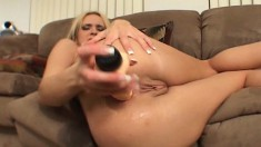 Naughty blonde begs you to look at her while she drills herself
