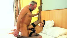Long-legged young beauty swallows this older fucker's fat prick