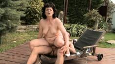 Irresistible GILF gets a sensual massage and fucks a young dude