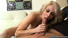 Angela Attison shows off the contours of her perfect body and sucks a big dick