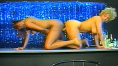 Busty black babes put on a live show of double dildo fucking in the club