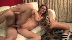 Lusty cougar and her sexy young cub share a big cock in a wild threesome
