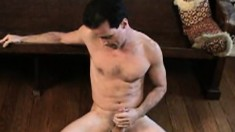 Dark-haired stud Roger relaxes by masturbating on the floor and couch