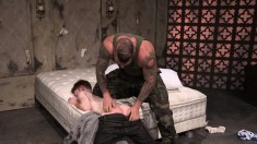 Tattooed Soldier Pushes His Mate Down On The Bed And Chokes His Pecker