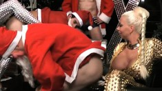 Busty Blonde Bends Over To Take In Santa's Vigorous Fuck Rod