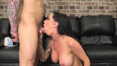 Tattooed brunette toys on the couch, trades head and gets drilled