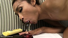 Skinny ladyboy slides a glass dildo deep in her tight ass and jerks her big dick