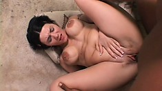 Spreading her hot legs, the busty brunette has him filling her cunt with his huge rod