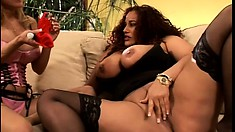 Two horny big breasted MILFs use sex toys to make each other come