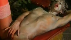 Painted up blonde in stockings gets her glistening cunt slammed