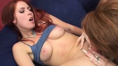 Saucy redheaded lesbian spreads her legs to get her pussy worked