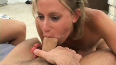 Buxom blonde milf Amber makes the most of her time with two young guys