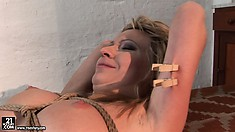 She clips her pussy lips, tongue and under her arms, then sets her up
