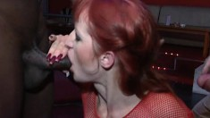 Wild redhead Olivia has a black guy and a white dude sharing her holes