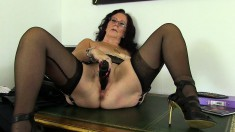 British mature lady Zadi drives a dildo in and out of her needy cunt