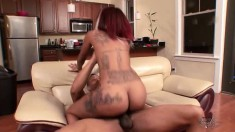 Inked up red bone babe with wild hair takes a ride on her homie