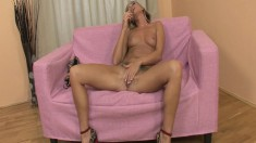Tanned blonde eye candy uses a dildo to drill her damp beaver