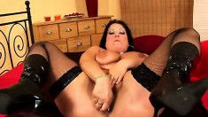 Curvy mature slut in black stockings Bea enjoys her time with a dildo