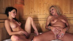 Old and young chick in the sauna take turns eating pussy and fingering