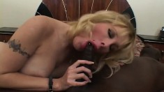 Nasty blonde amateur with big hooters explores her lust for black meat