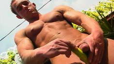 Muscled hunk loses his clothes and takes his cock to orgasm outside
