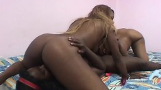 Xtacee and her lesbian lover fuck each other with sex toys on the bed