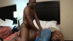Curvy ebony lady with a massive booty takes on a dark pole on the bed