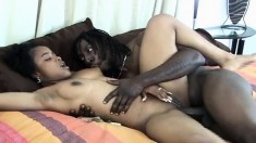 Ebony beauty with big natural tits spreads her legs for a black shaft