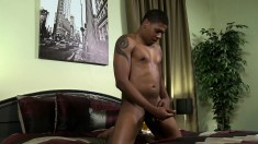 Hung ebony stud takes off his yellow shorts to play with his massive cock
