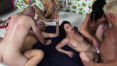 Five beautiful and lustful girls hook up on the bed for a torrid orgy