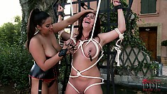 Busty mistress ties up her slave's big tits and licks her nipples