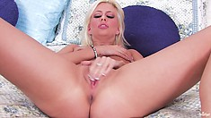 This blonde puts pressure right on her sweet clit and rubs away