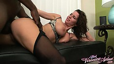Screams of pleasure echo around the room as the busty milf gets fucked hard doggy style