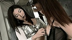 Dominatrix lesbian calls over her slave and starts chaining her up