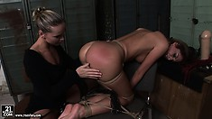 Now she's getting her hot looking ass spanked and sucks the dildo