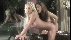 Two lovely lesbians in a very sensuous scene eating and fingering pussy