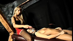 Naughty brunette slave gets ball gagged and whipped by her lesbian mistress