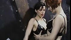 Hot bitch gets dominated by her lovely mistress in a dungeon