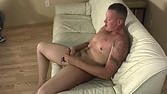 Handsome stud with nice tattoos jacks off all over the couch