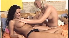 Dazzling lesbian lovers Zsuzsanna and Beola have fun in the dorm room