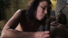 Busty mature lady seizes the chance to suck and fuck a big black stick