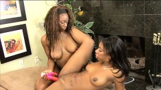 Caramel lesbians using their favorite sex toys to make each other cum