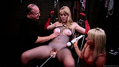 Another blonde helps out and gets hooked up to a fuck machine